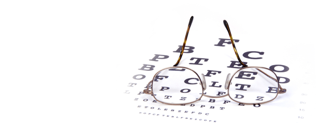 an image of a pair of glasses sitting on an eye chart