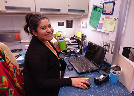 an image of a Peach Tree employee hard at work at her work station