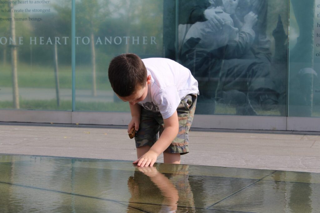 an image of a boy at a memorial