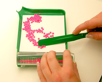 an image of a pharmacist counting out pills for a patient