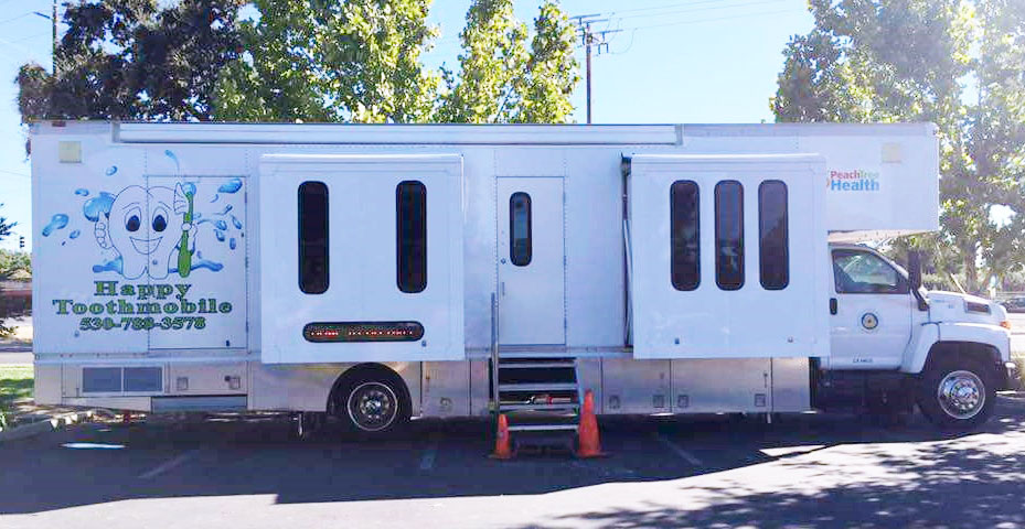 an image of the Peach Tree Health Happy Toothmobile Clinic